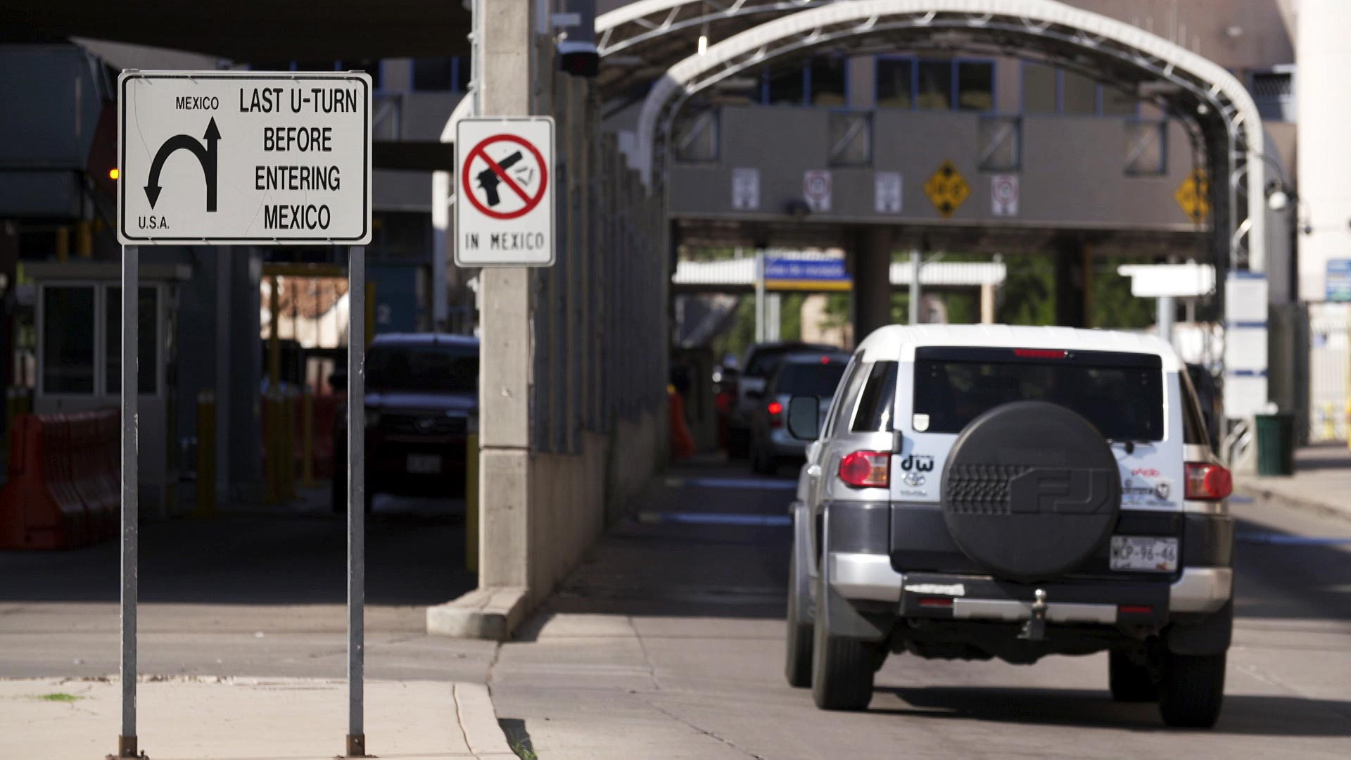 Vehicles drive south into Mexico through the DeConcini Port of Entry in Nogales, Ariz. August 2020.