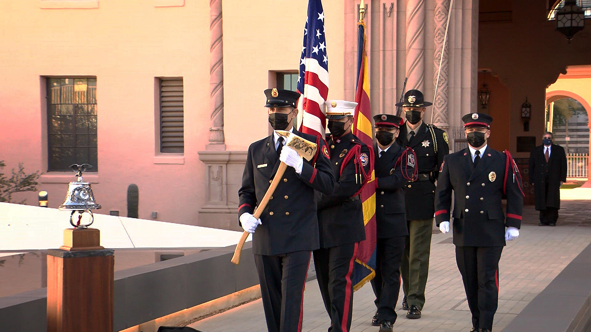 An honor guard delivers the Arizona and United States flags into a dedication ceremony for the January 8th memorial at the Historic County Courthouse in downtown Tucson on Jan. 8, 2021. The memorial, called Embrace, was unveiled on the 10th anniversary of the mass shooting.