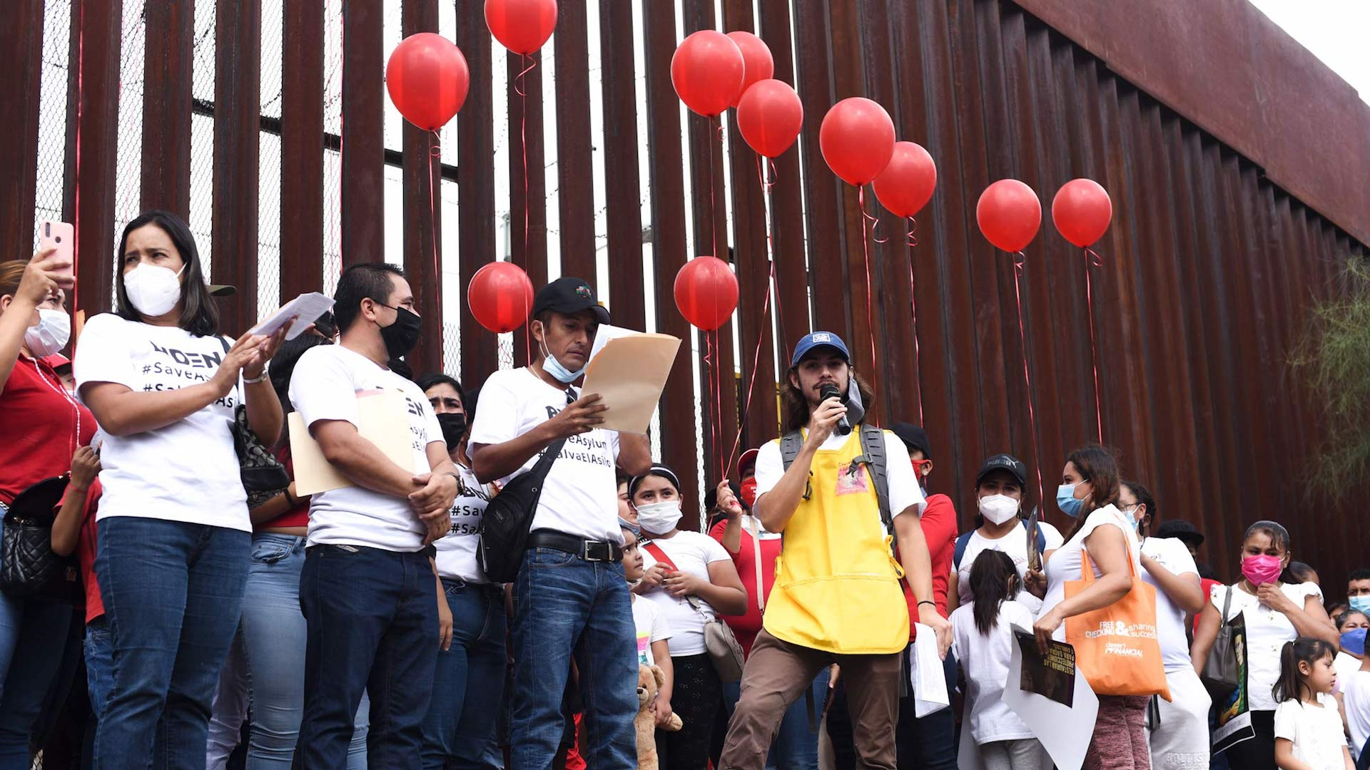 Migrants, advocates and faith leaders gather on both sides of the border wall in Nogales to read out the names of families seeking asylum and give testimonies.