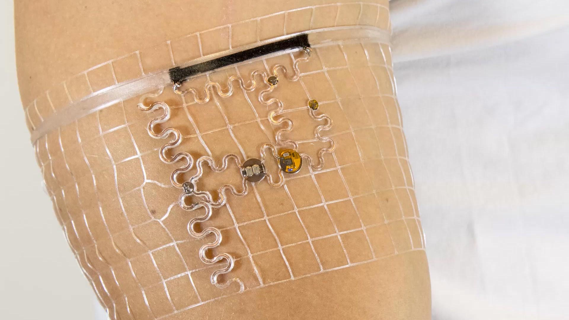 Tiny sensors are embedded in a fitting mesh structure worn like a sleeve.