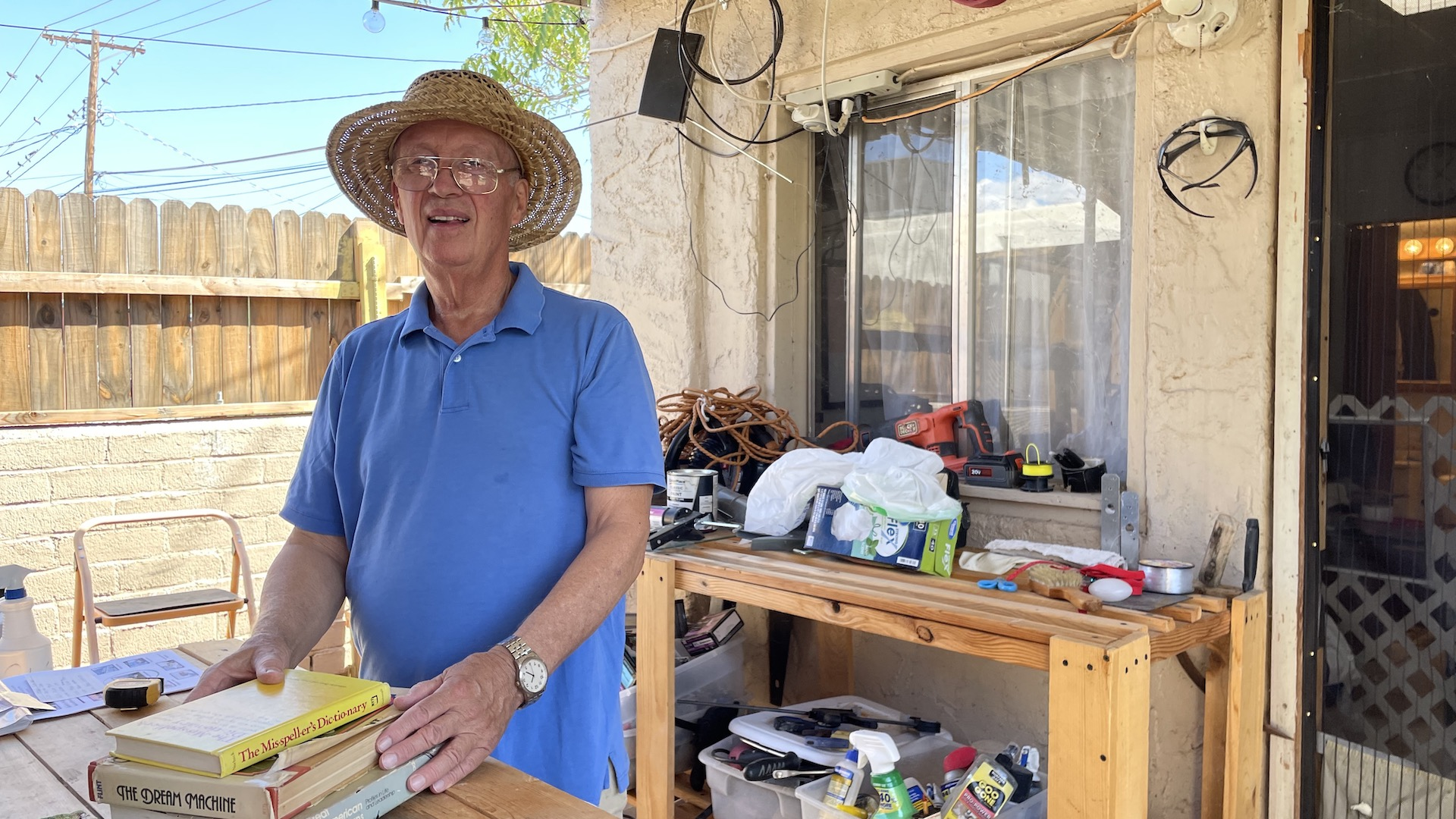Peter Norbeck, 79, stands in front of his casita and woodworking desk on October 1st, 2021.