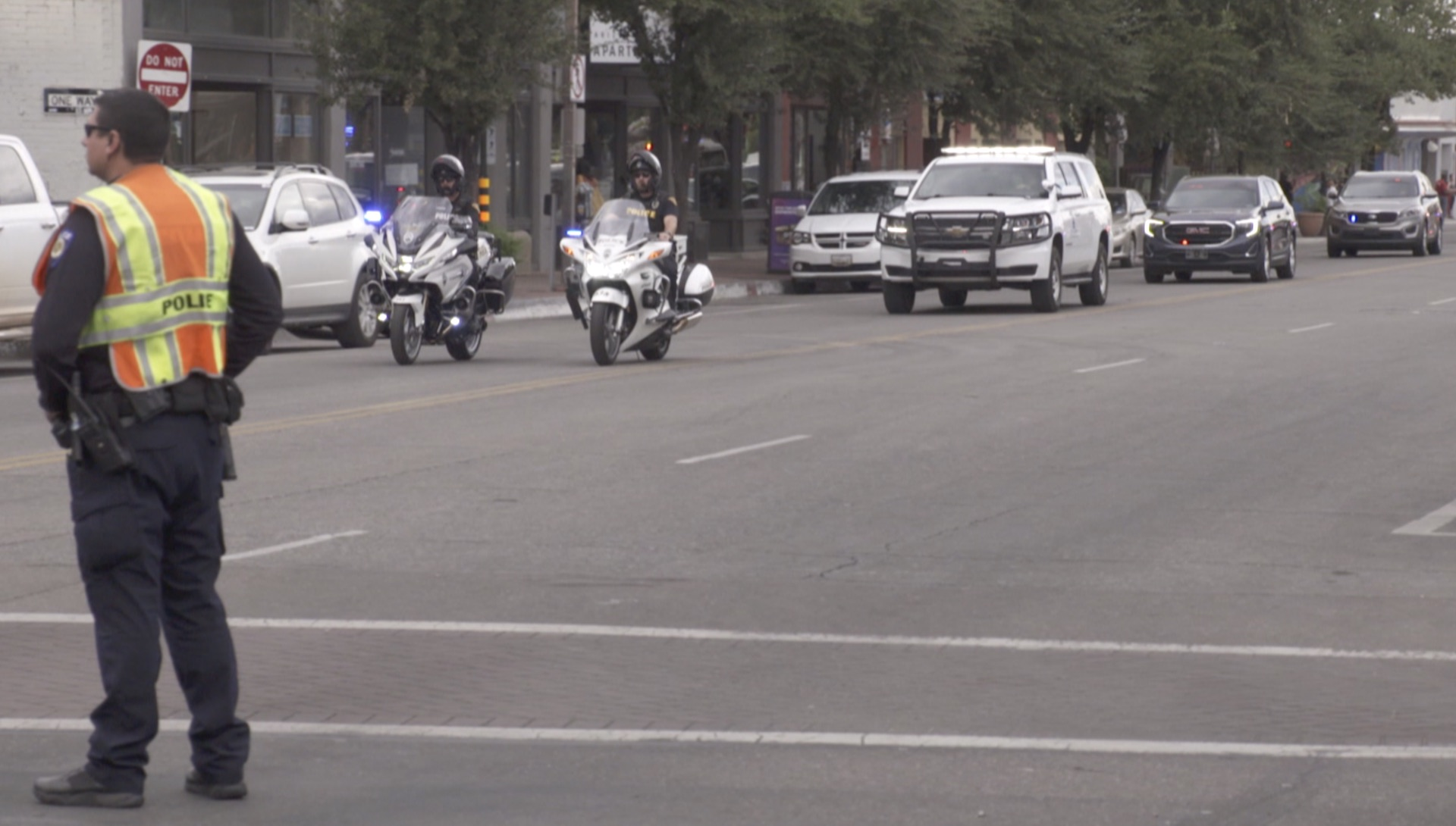 Police escort a vehicle carrying the body of Drug Enforcement Administration Group Supervisor Michael G. Garbo on Tuesday, October 5, 2021 after he was killed during a shootout at the Amtrak train station in downtown Tucson.