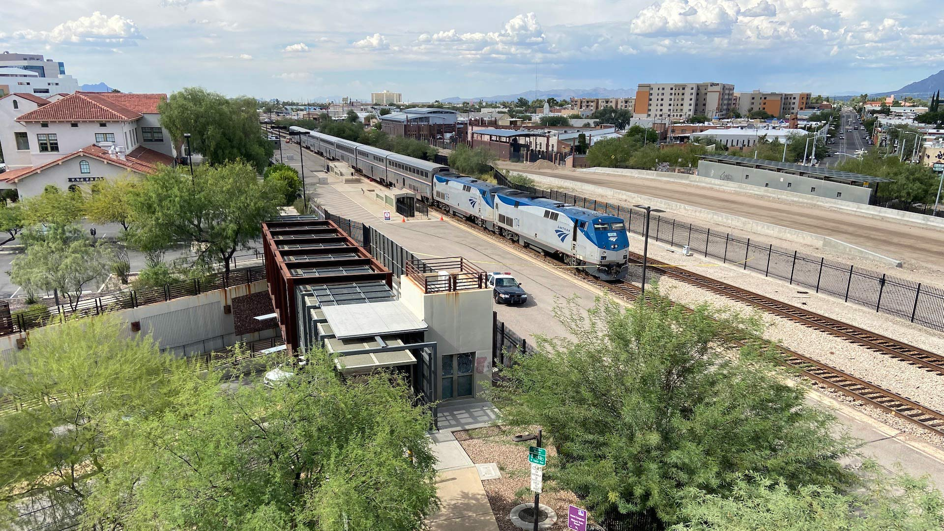 Police say a U.S. Drug Enforcement Administration special agent and another person were killed during a shootout on an Amtrak train that stopped in downtown Tucson on Monday morning.