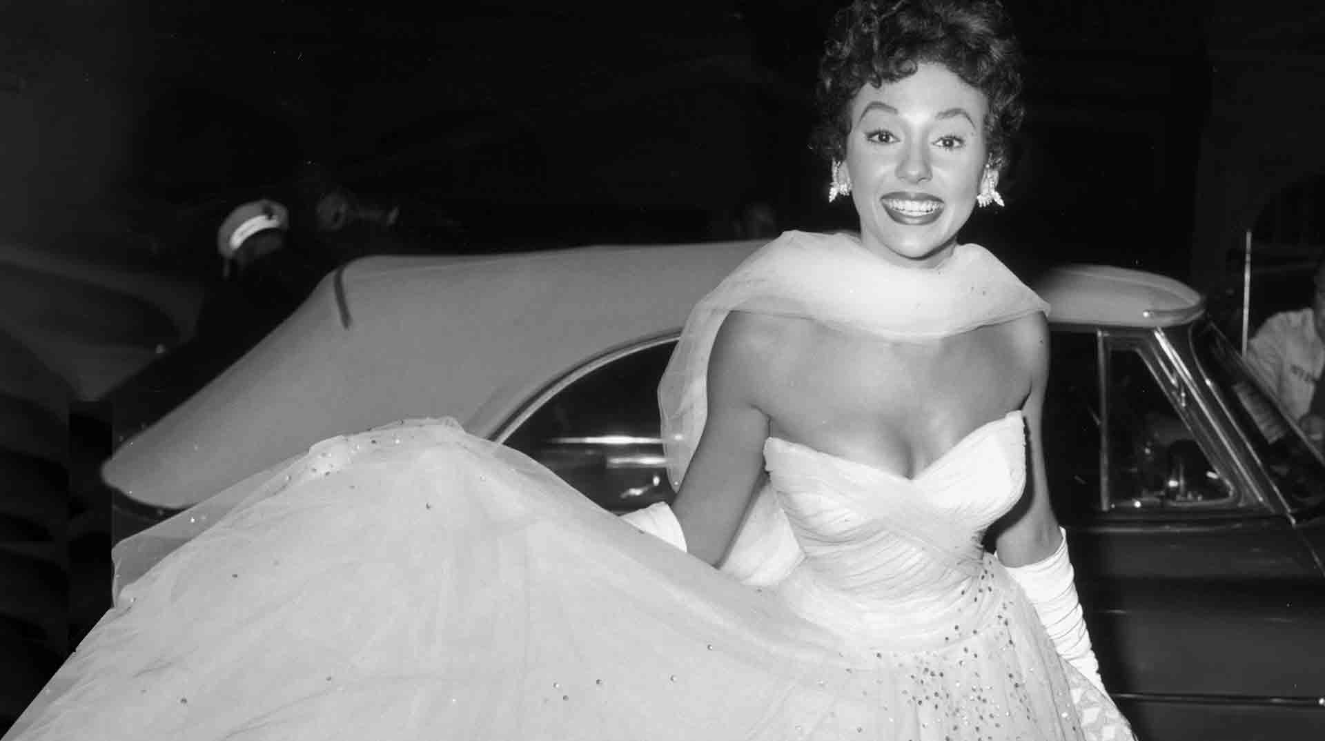 Rita Cocktail Dress in front of Car.