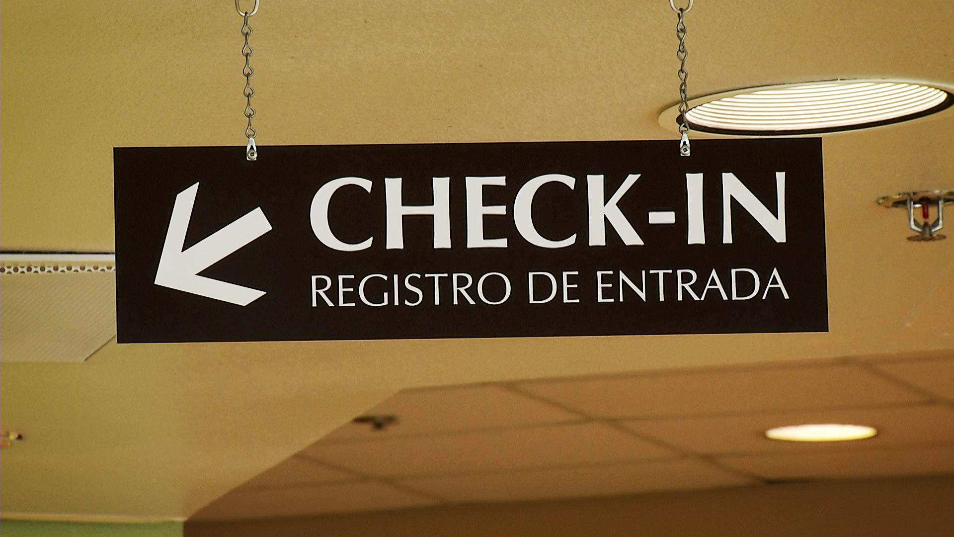 A sign in the lobby of Tucson Medical Center directs people where to check in.
