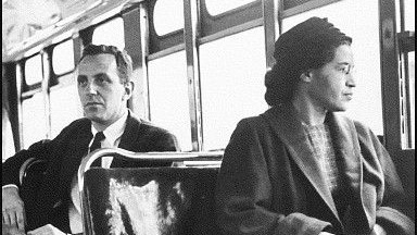 Rosa Parks is most famous for her peaceful protest on a Montgomery, Alabama bus on December 1st, 1955. This staged photo was taken later.