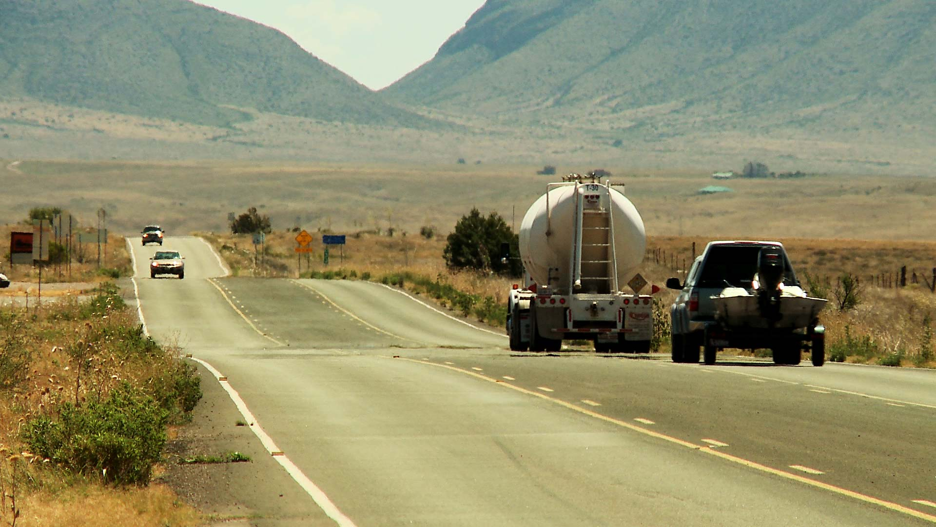 Vehicles travel along a highway near Sonoita, Ariz.