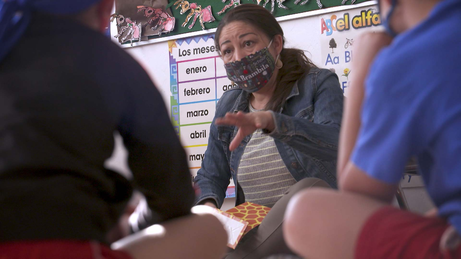 A masked teacher offers instruction to a Spanish class at the International School of Tucson. February 2021.