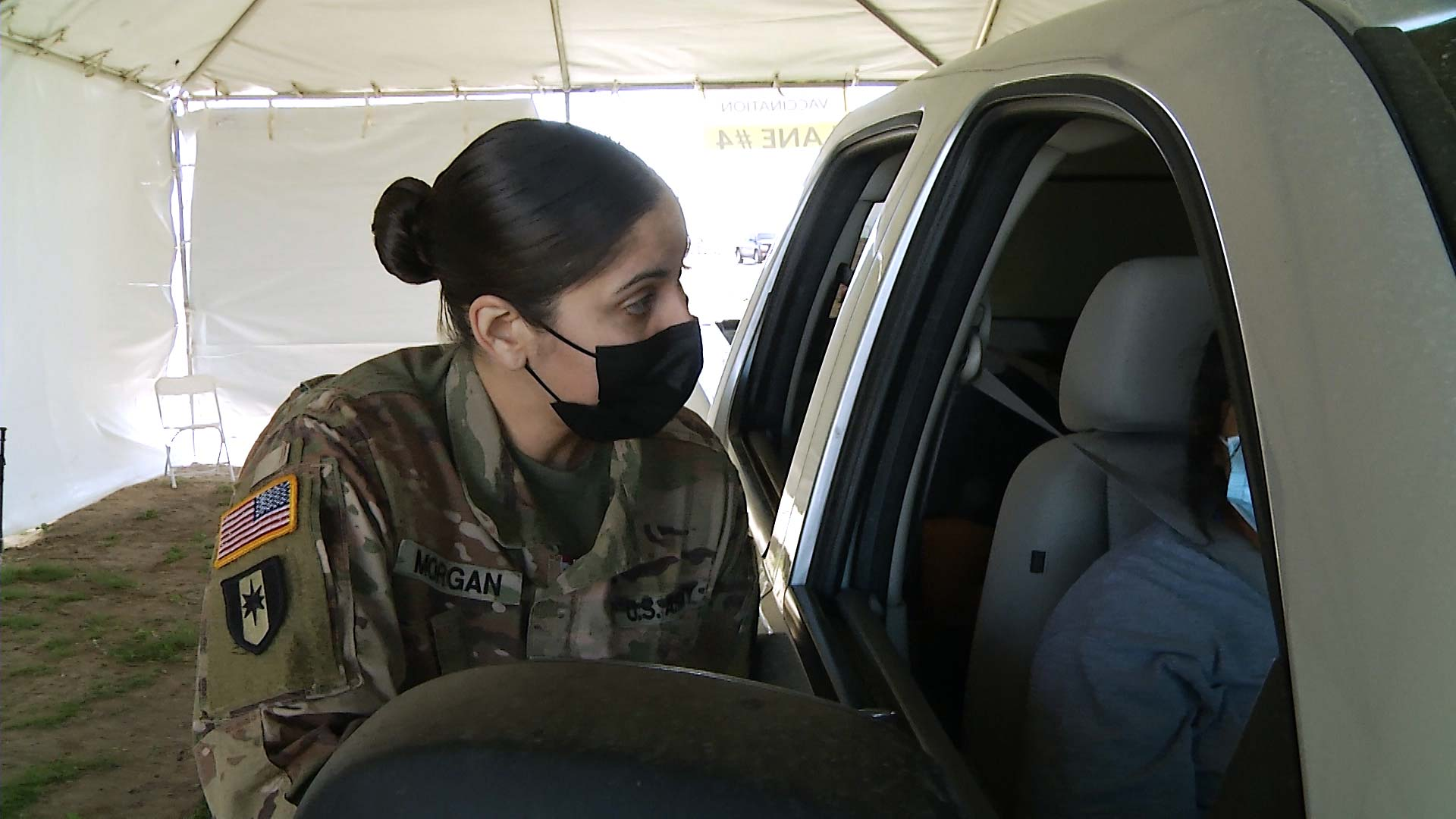 A member of the Arizona National Guard speaks to a COVID-19 vaccine recipient at a vaccination event at Wild Horse Pass Motorsports Park on the Gila River Indian Reservation on Feb. 20, 2021.