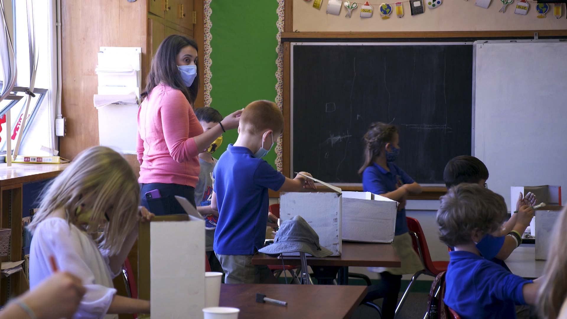 A teacher and students all wear masks while in the classroom at the International School of Tucson. February 2021.