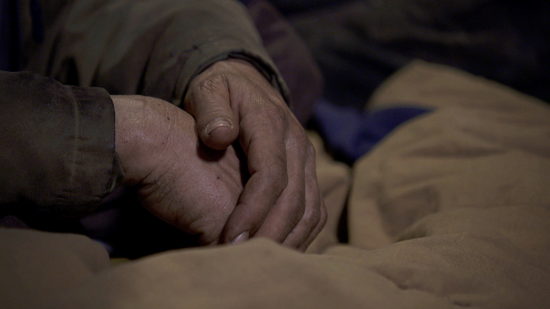 A close up of the hands of a man experiencing homelessness in Tucson. February 2021.