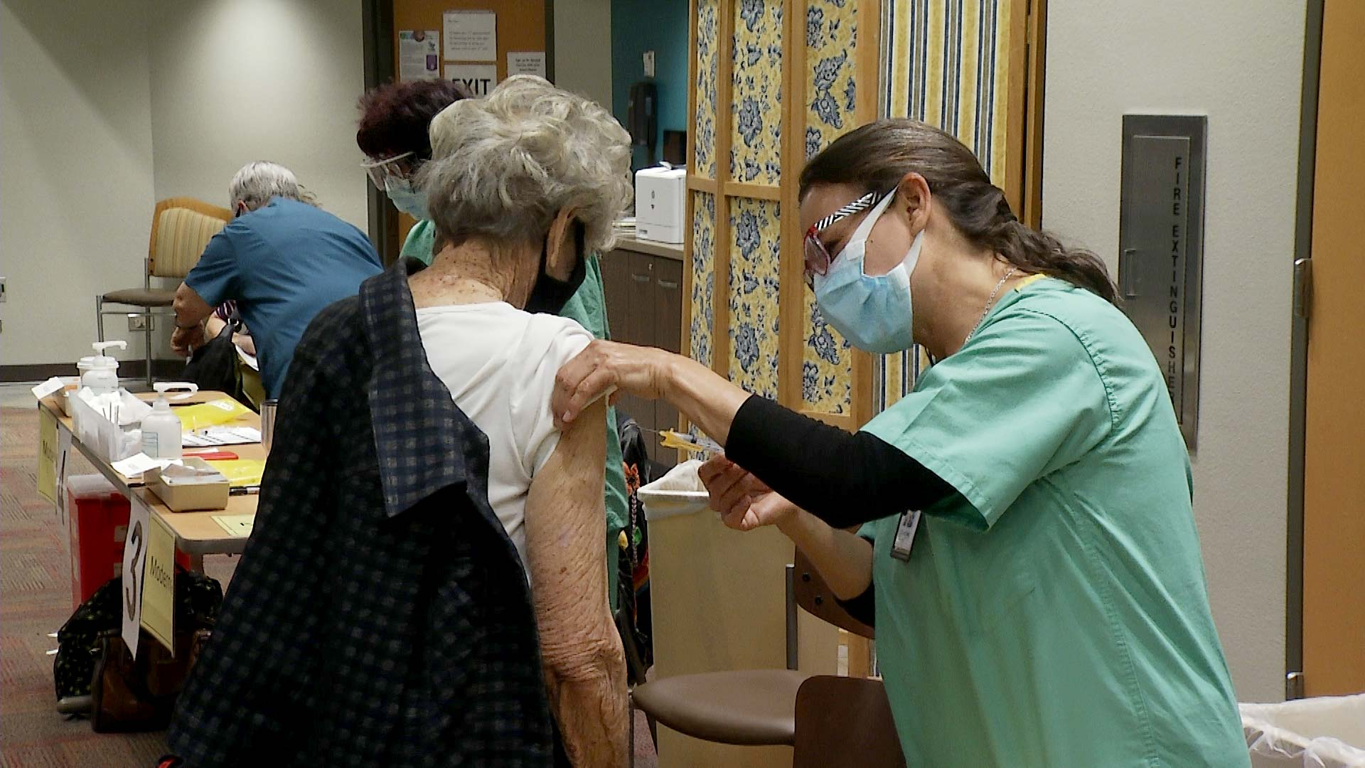 A woman receives a COVID-19 vaccine at Tucson Medical Center. January 2021.