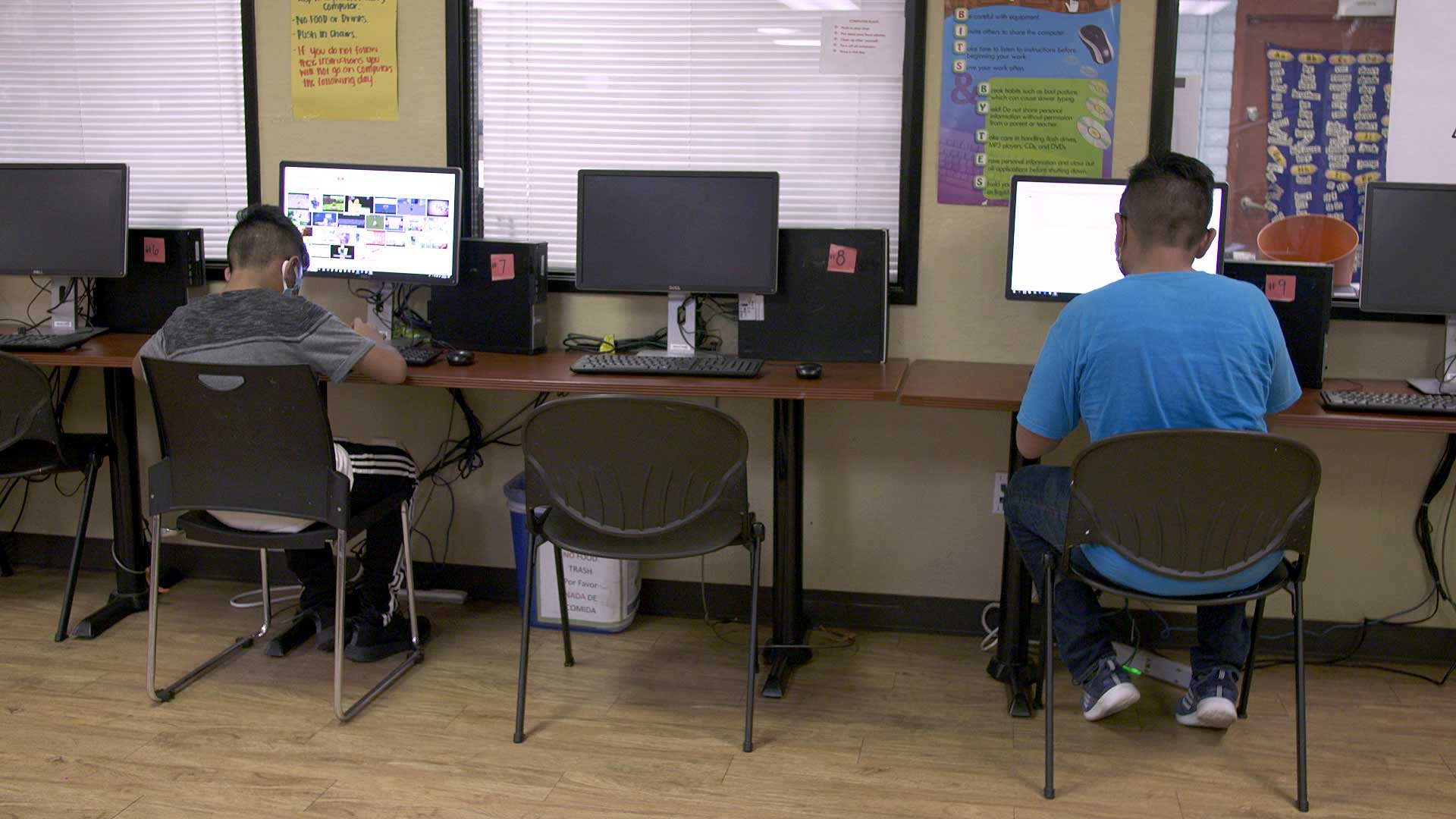 Two children use computers to complete their school work online in a computer lab at the nonprofit Chicanos Por La Causa in Phoenix. August 2020.