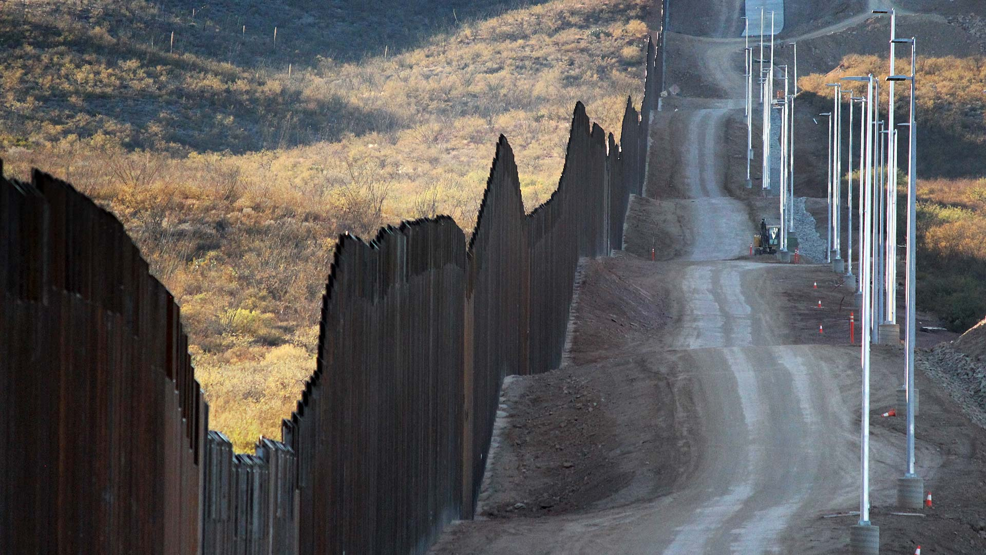 A stretch of border fencing east of Douglas constructed as part of President Trump's initiative to erect a taller wall along the southern border. November 2020.