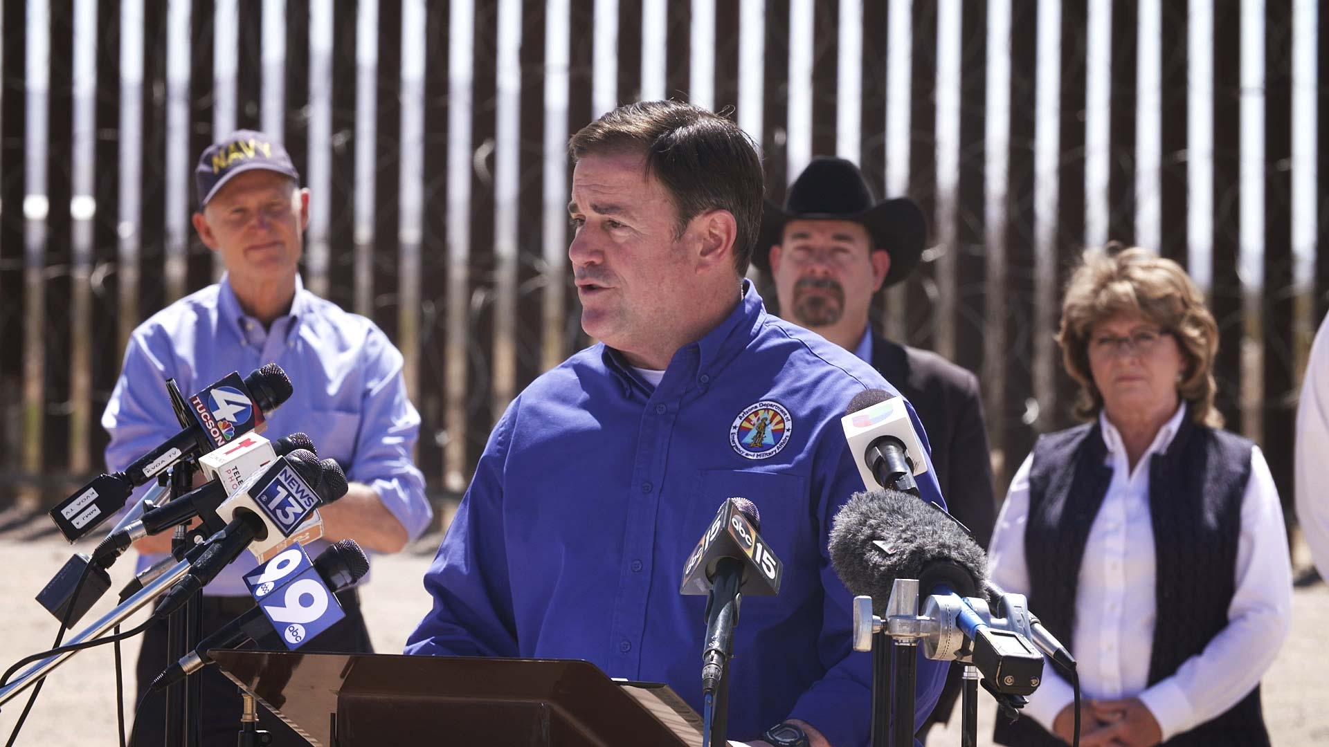 Arizona Gov. Ducey speaks to reporters at a news conference held along the border in Douglas on March 19, 2021.