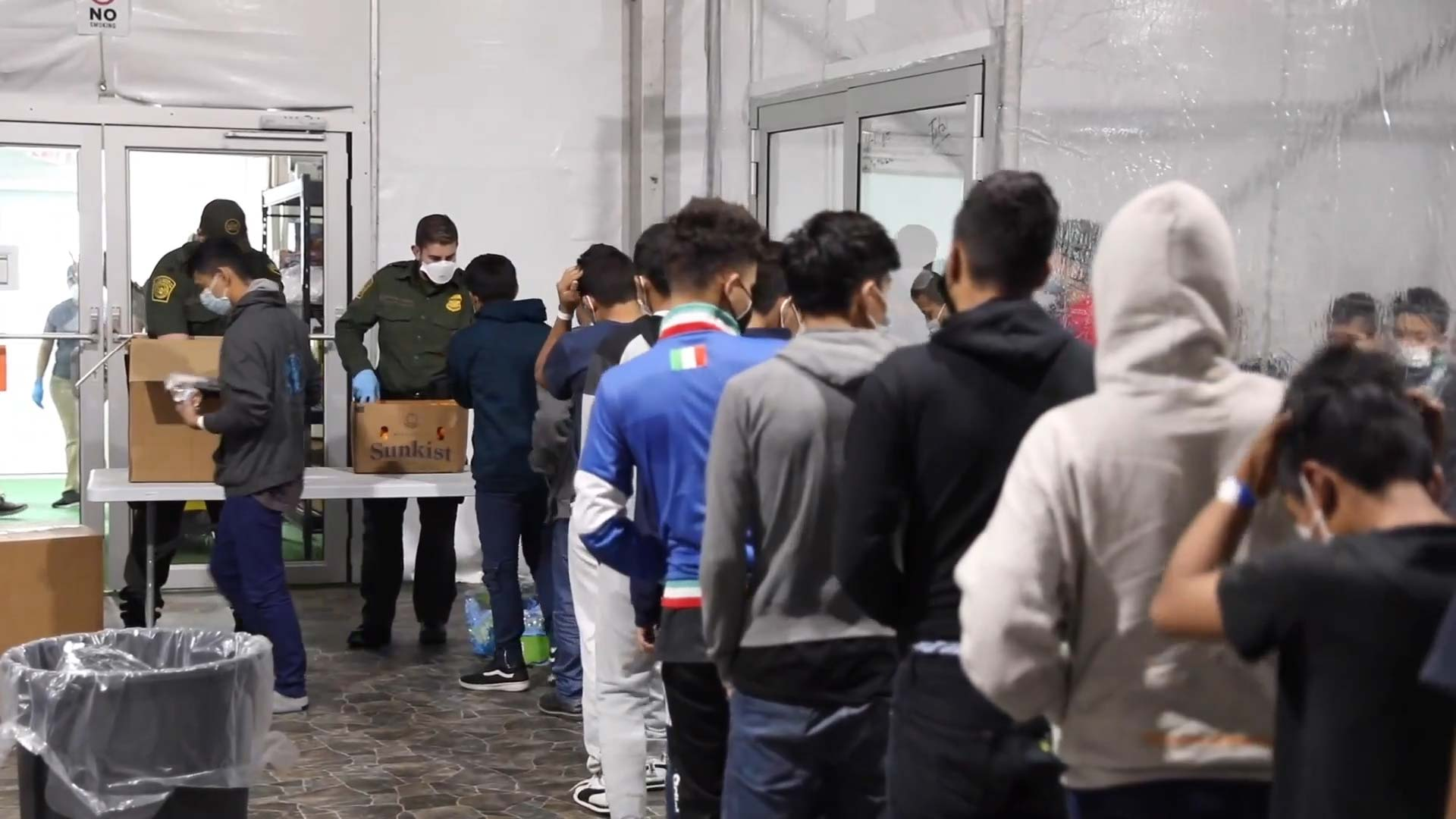 Unaccompanied minors apprehended by Customs and Border Protection line up inside a temporary processing facility in Donna, Texas on March 17, 2021.