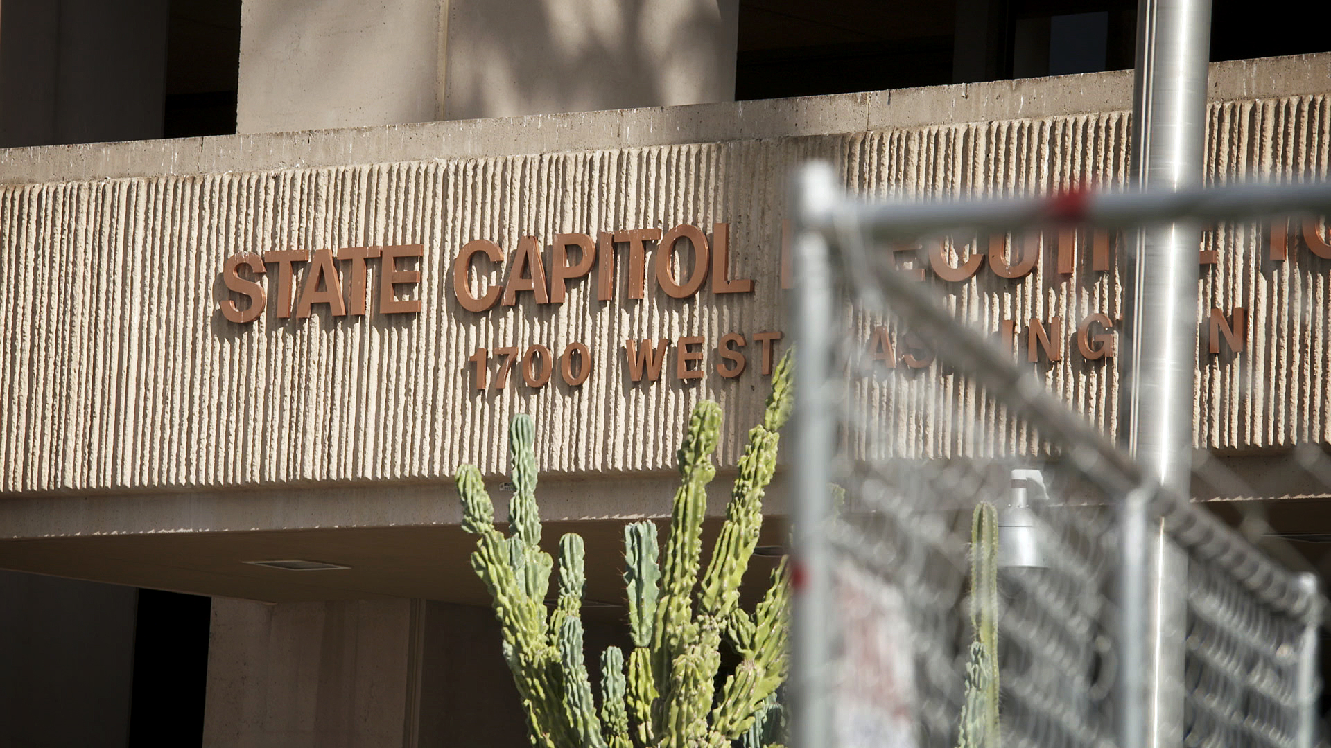 A sign above an entry at the Arizona State Capitol in Phoenix. 2021.