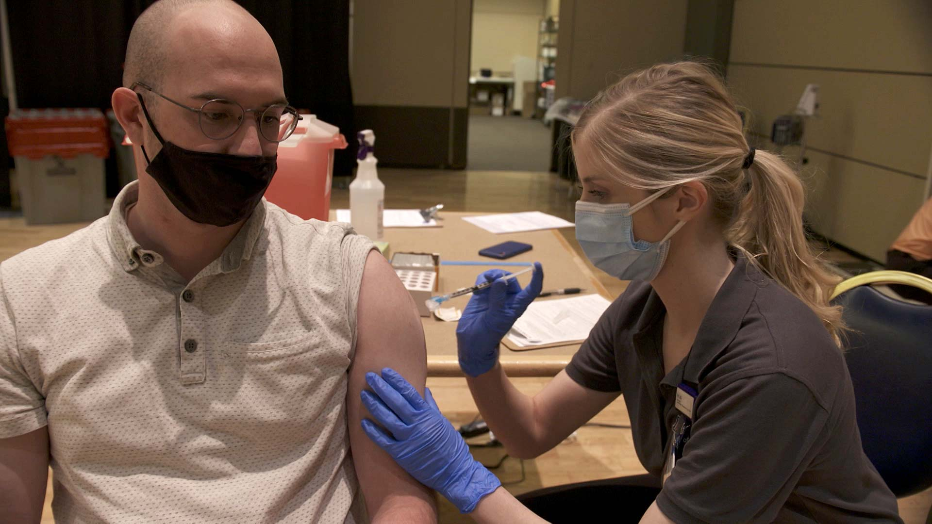 University of Arizona student Blake Gerken receives a dose of Moderna's COVID-19 vaccine at the campus's Student Union Memorial Center on April 16, 2021 as a participant in a nationwide vaccine study involving more than 20 universities.