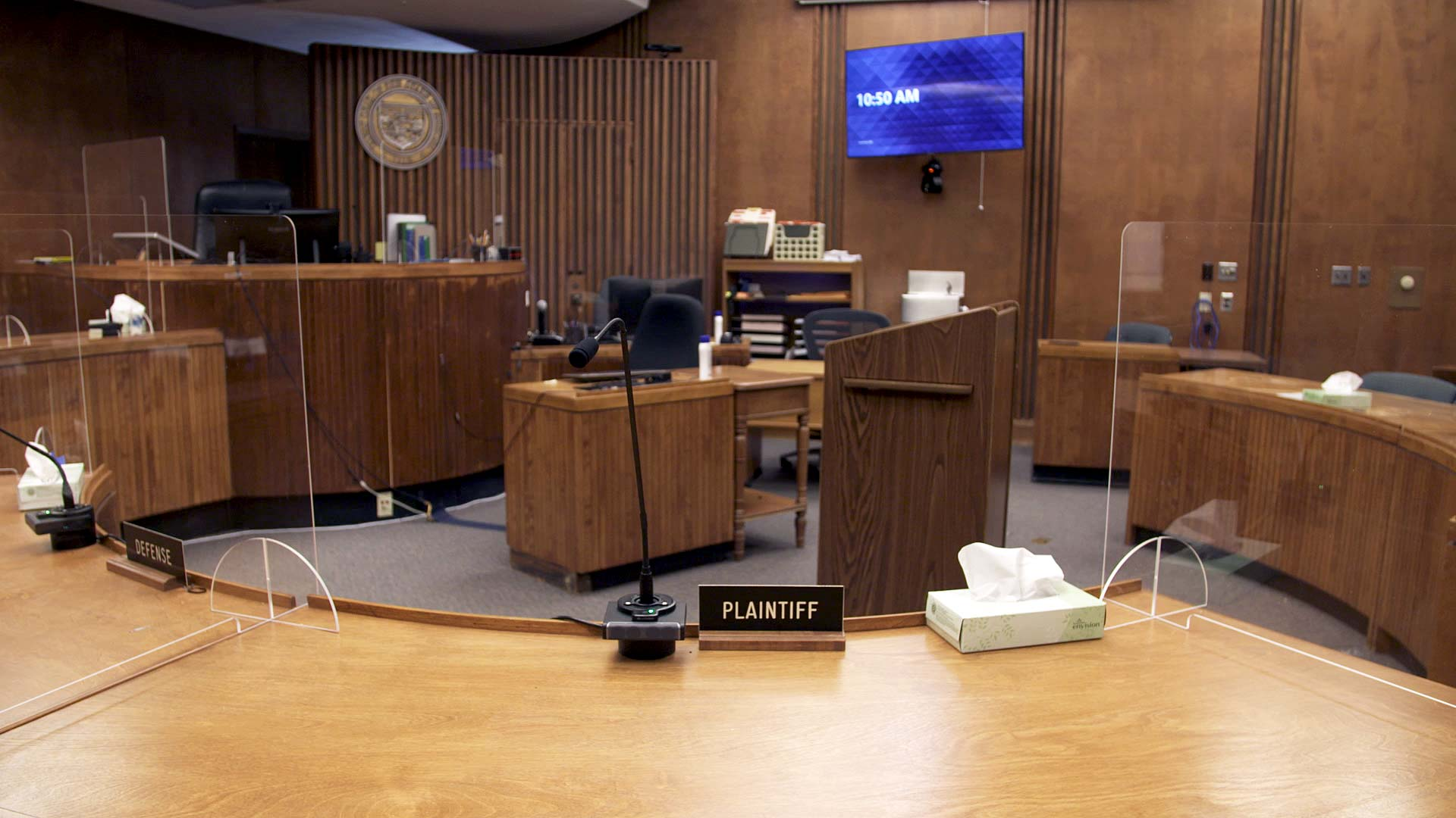 Plexiglass dividers are set up throughout a courtroom at the Pima County Superior Court as part of the building's COVID-19 mitigation protocols. April 2021.