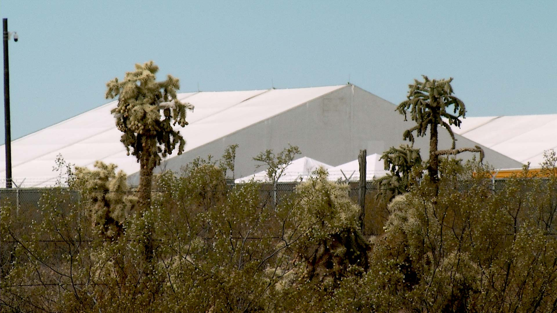 The exterior of a temporary, tent facility run by Border Patrol for unaccompanied children in unincorporated Pima County. April 2021.