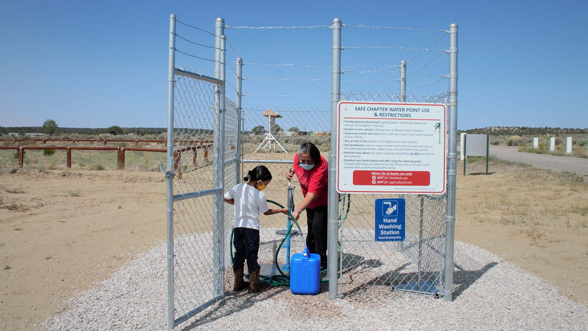 Navajo Nation family getting clean, drinking water at the local well during the COVID-19 pandemic.