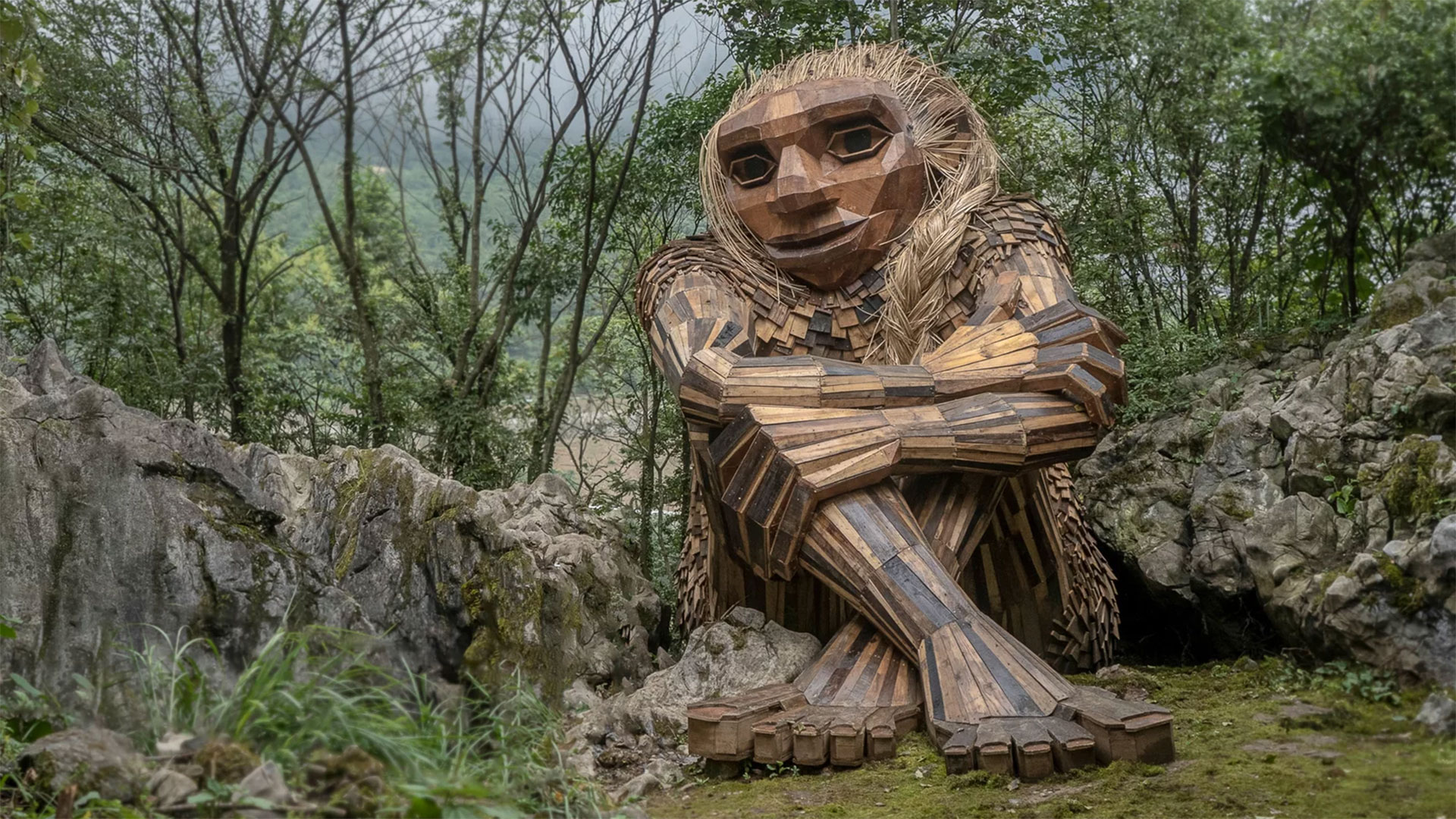"""""""Recycle art activist"""" Thomas Dambo makes gentle giants from scrap wood, old pallets, twigs and debris. Above, the troll Marit in It Sounded Like a Mountain Fell in Wulong, China."""