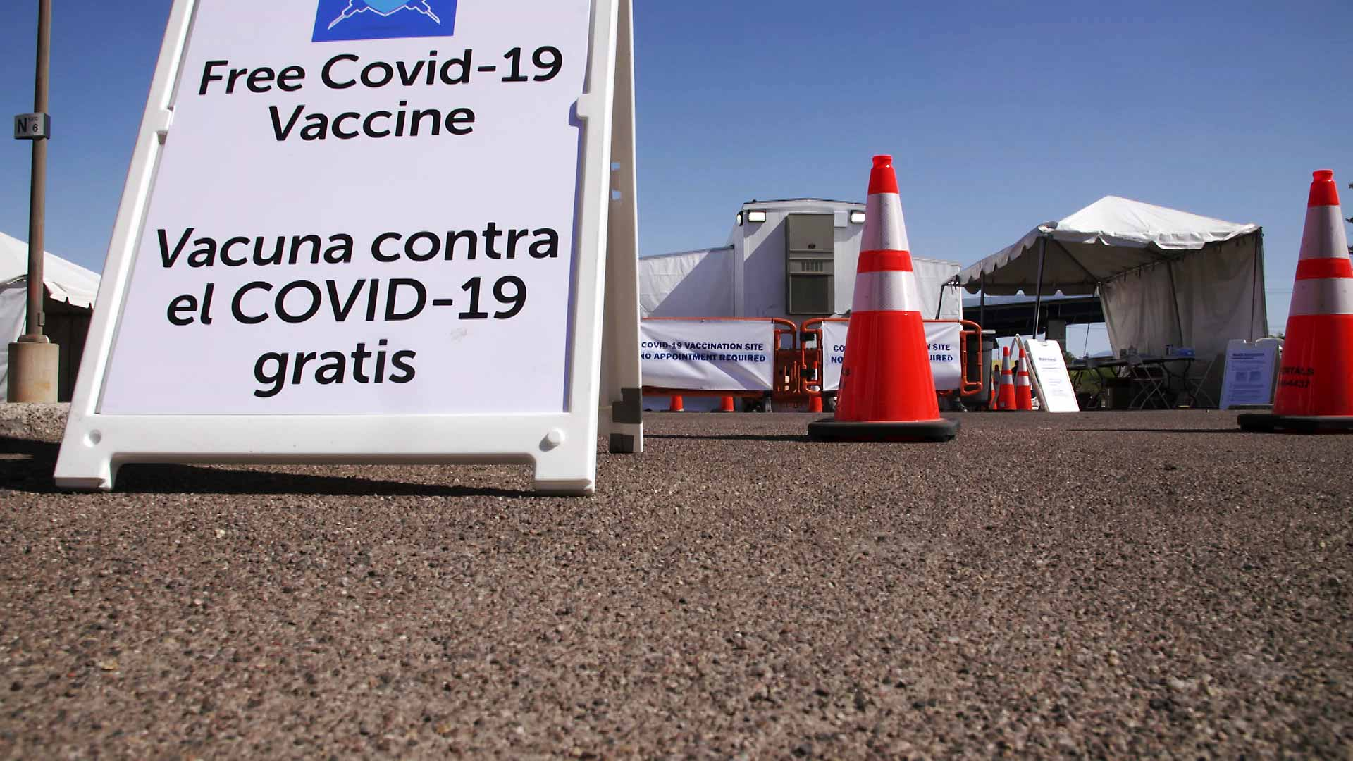 A sign advertising free COVID-19 vaccines at a mobile vaccination unit operated by FEMA at Pima Community College's Desert Vista Campus on May 3, 2021.