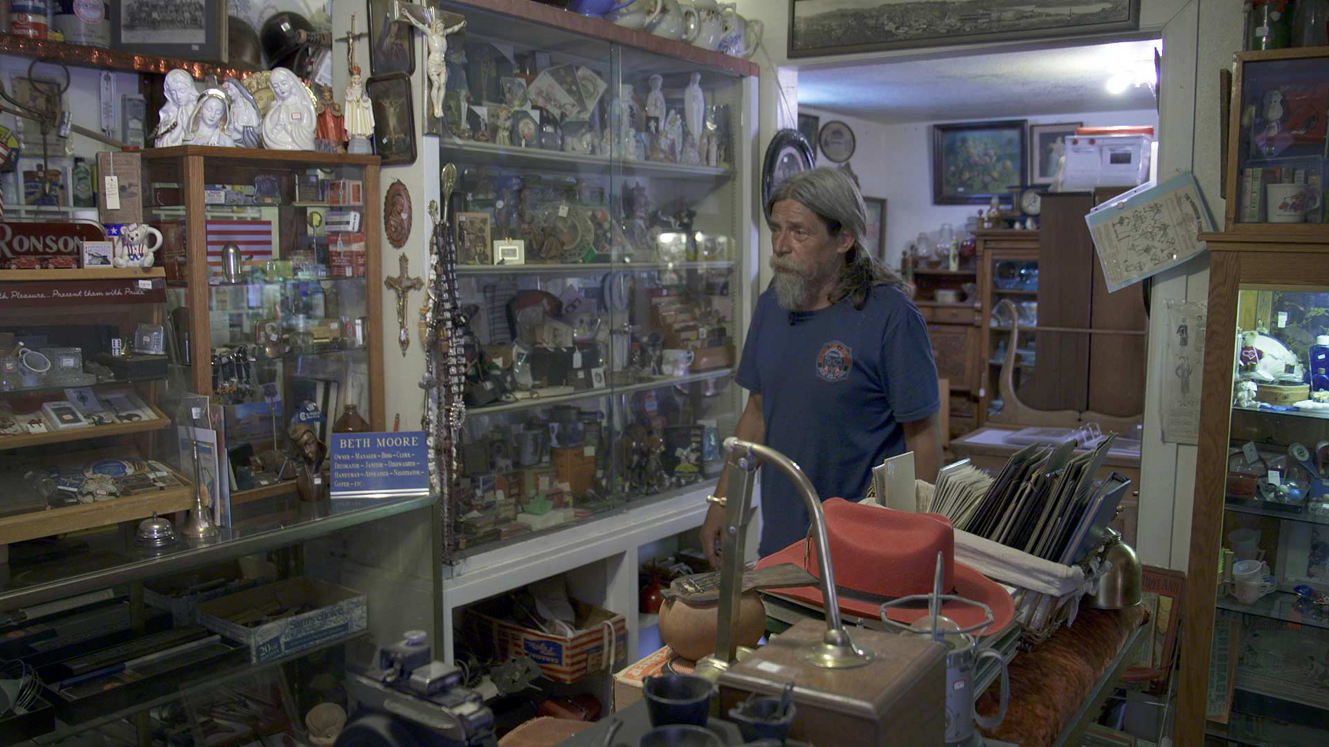 Rick Williams moves about his antique shop in Top-of-the-World on June 15,2021. He and his wife briefly evacuated the community when the Telegraph Fire began to encroach on the area.