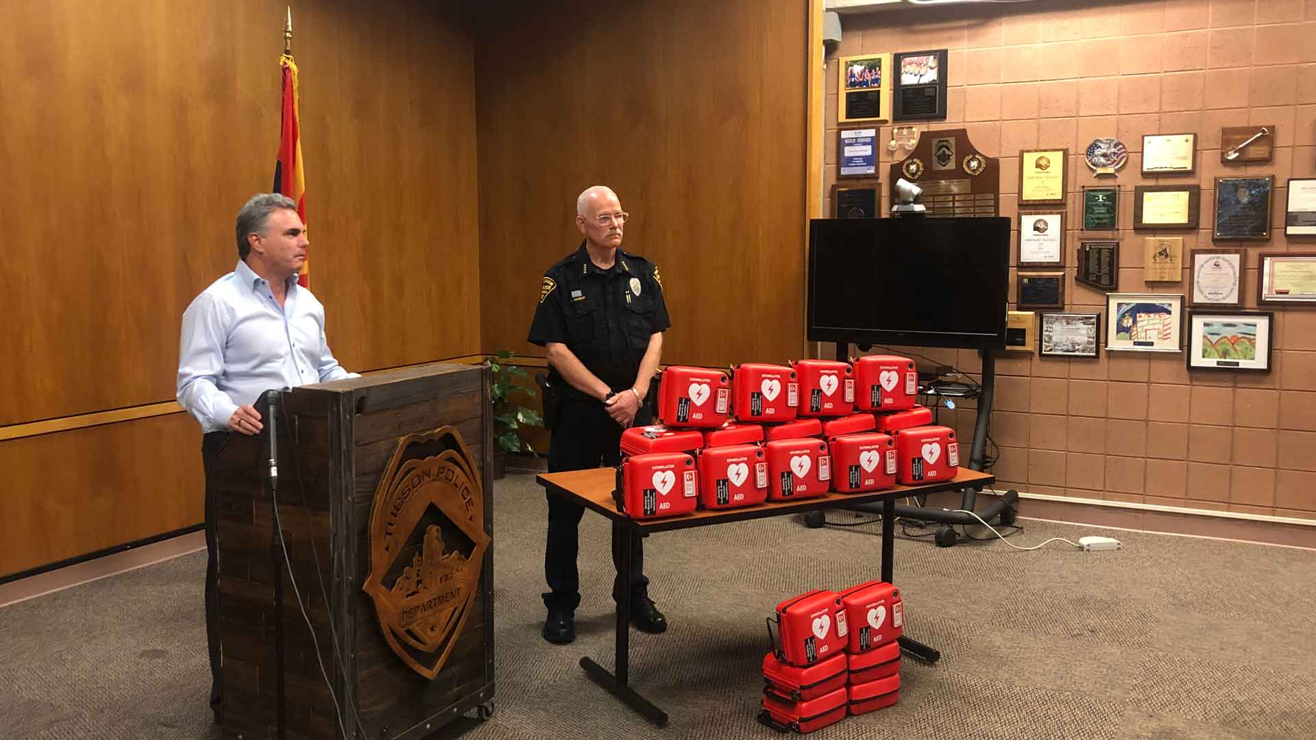 Tucson Police Chief Chris Magnus receives 25 AEDs from Andrew Messing, the president of the Steven M. Gooter Foundation. June 22, 2021