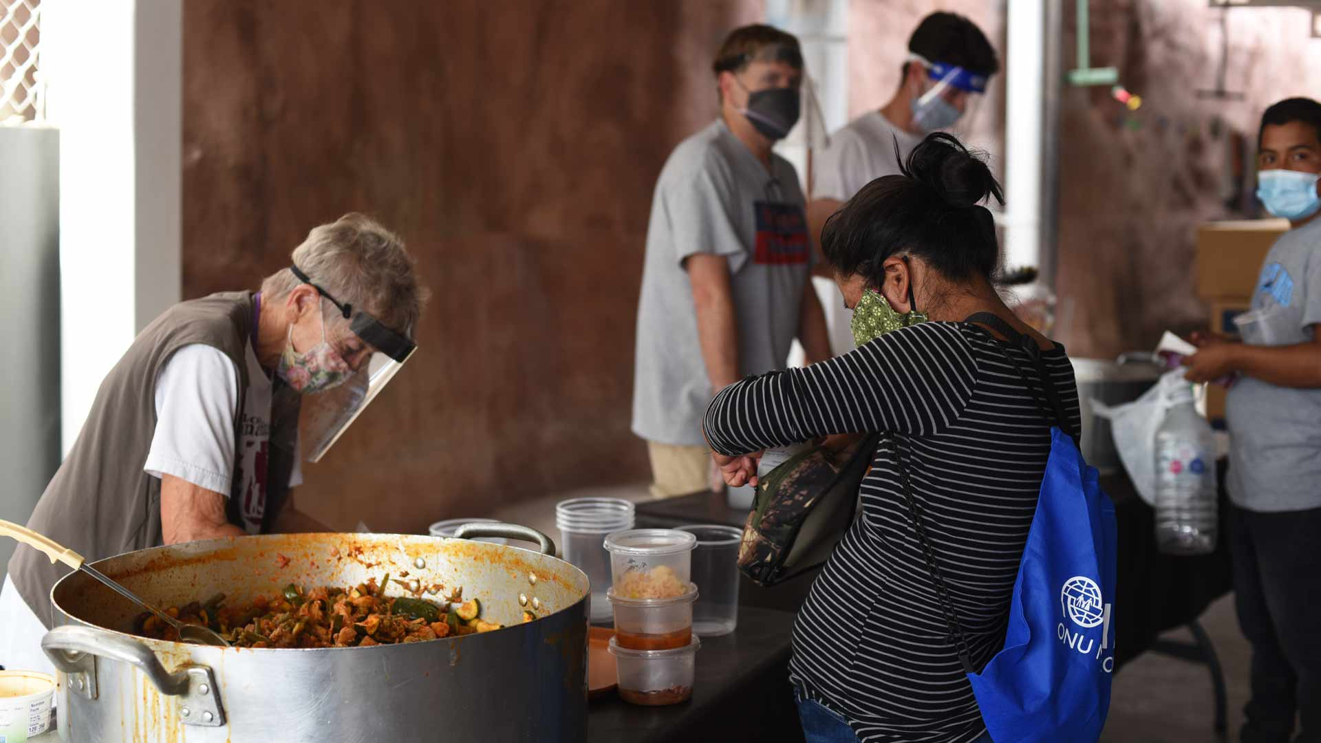 A migrant receives a serving of breakfast at the Kino Border Initiative in Nogales, Sonora. The faith-based shelter offers food, showers and other services, and also partners with legal aid groups to offer case assistance.
