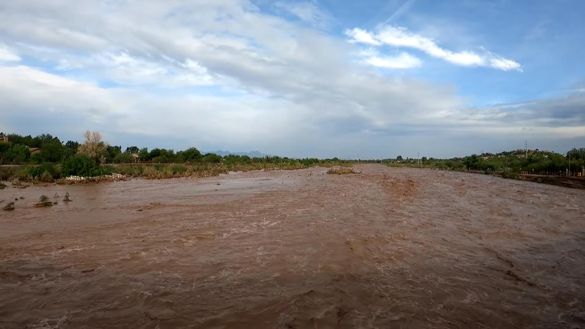 Waters from monsoon storms filled the Rillito River. July 2021.