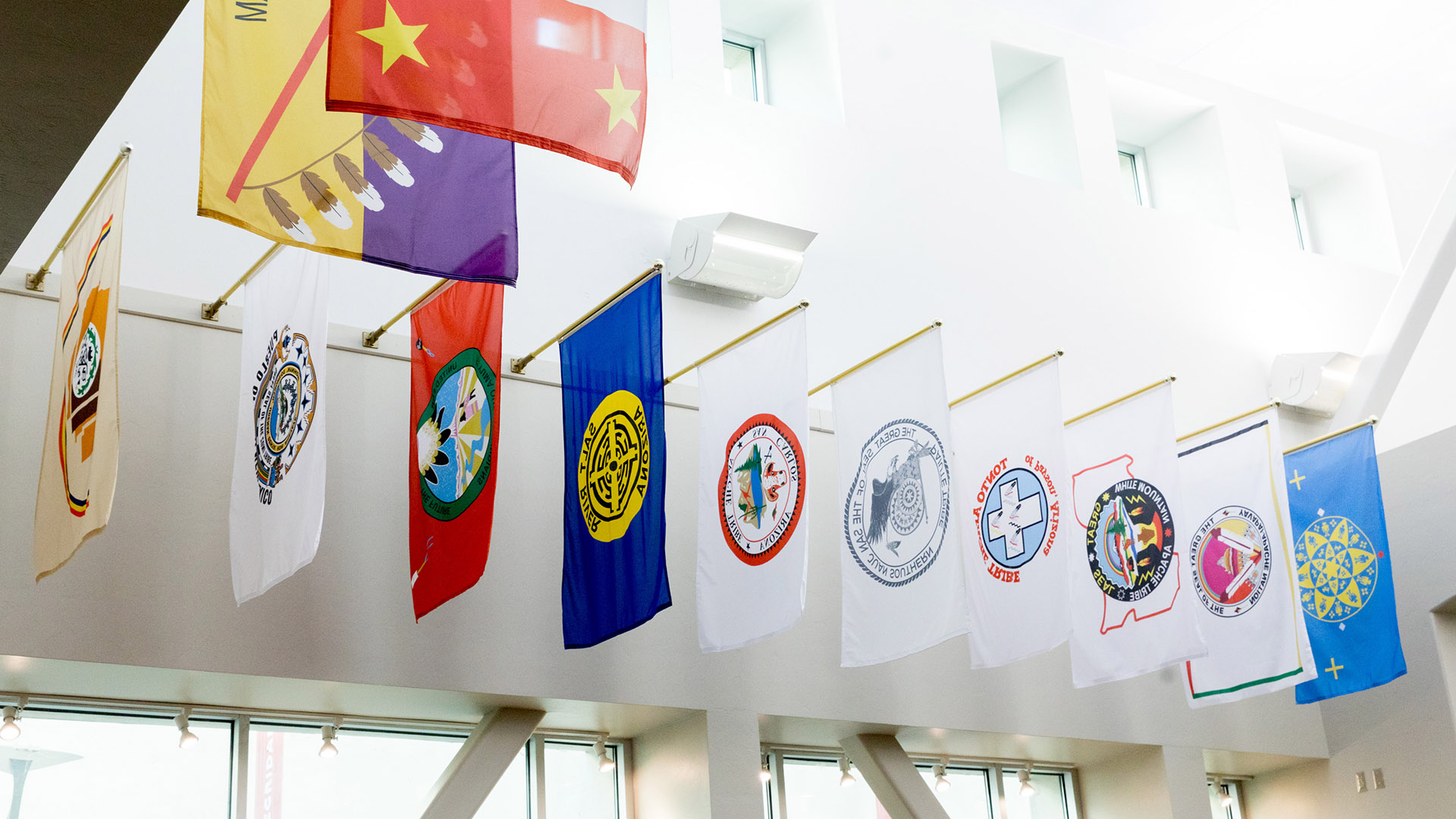 Flags from Arizona's 22 federally recognized tribes displayed at the University of Arizona bookstore in November 2020.