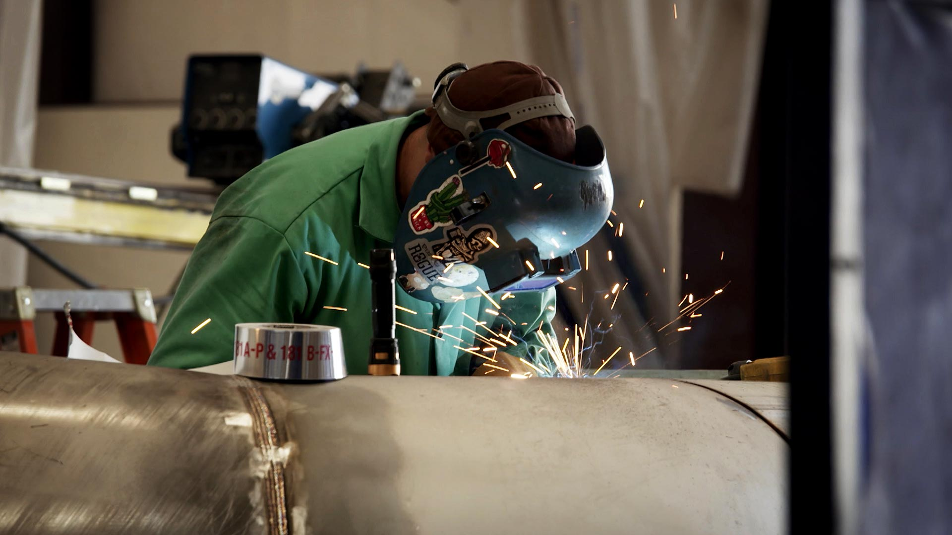 A welder at work at CAID Industries in Tucson. June 2021.