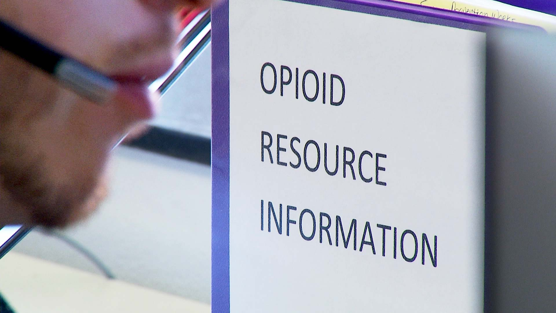 A folder with opioid resource information inside the Arizona Poison and Drug Information Center. January 2020.