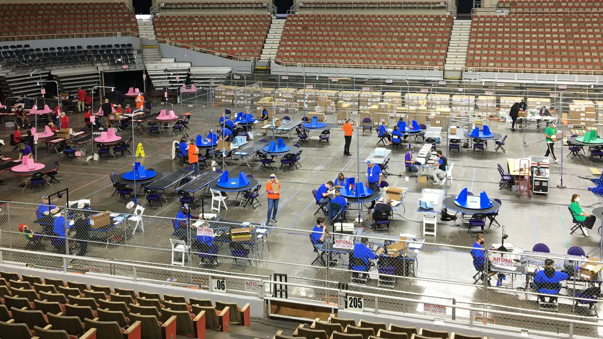 The Arizona Senate's contractors count ballots from Maricopa County inside the Veterans Memorial Coliseum during May 2021.