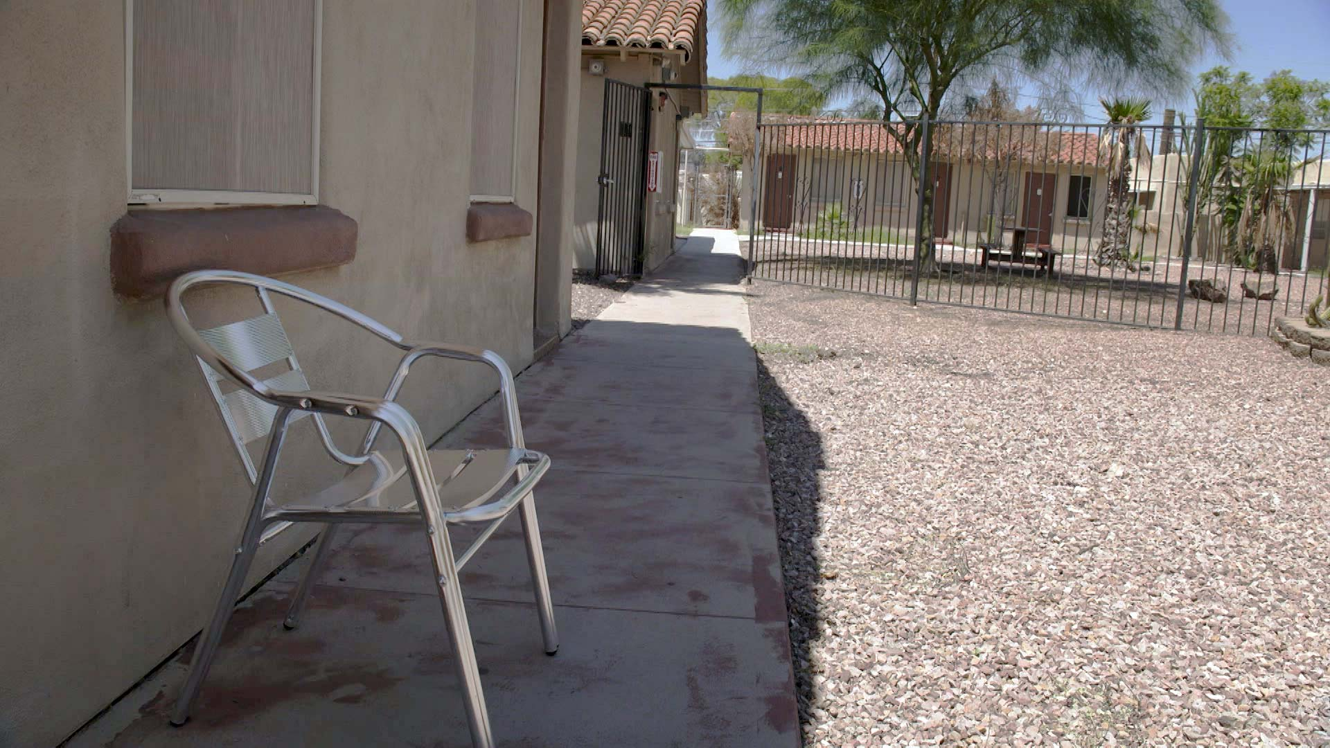 An empty chair outside of a former motel on North Oracle Road that the city of Tucson purchased and transformed into bridge housing for people experiencing homelessness. August 2021.