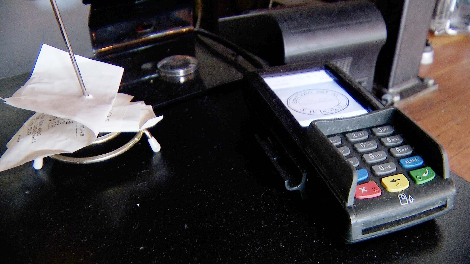 A credit card reader belonging to a business inside American Eat Company in Tucson.