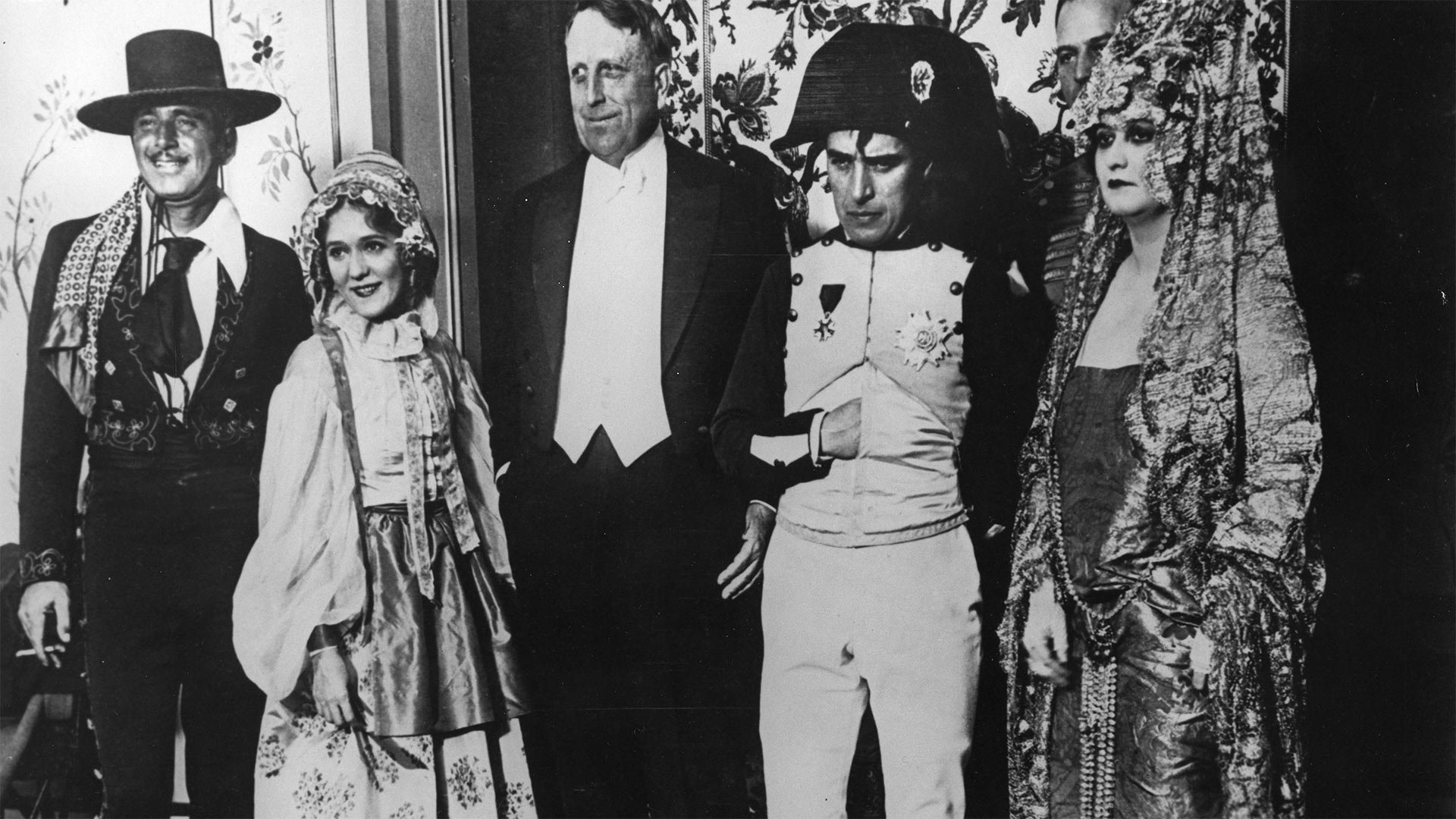 William Randolph Hearst (center in tuxedo) with party attendees (from left to right) Douglas Fairbanks, Mary Pickford, Charlie Chaplin and Princess Bibesco.