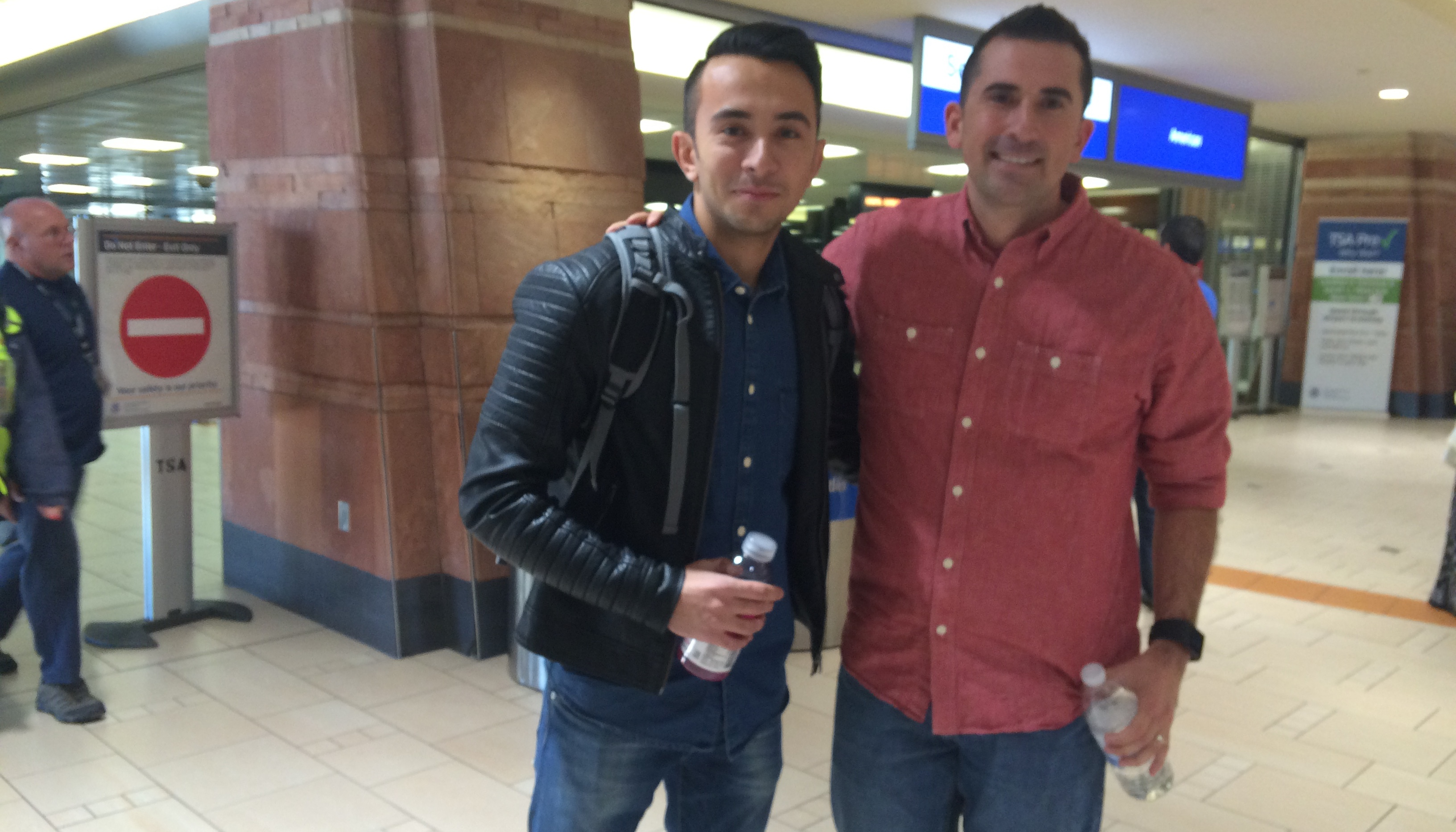 Aaron Marquez (right) and his former interpreter Alex (left), reunited at Phoenix Sky Harbor Airport in 2015. In the wake of the U.S. withdrawal from Afghanistan, the Biden administration says it plans to resettle tens of thousands of Afghans in the U.S., including many who helped American troops.