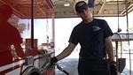 Fireman Fueling a fire truck