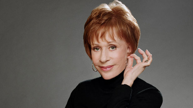 "Carol Burnett, shown tugging her ear, a gesture with which she ended each broadcast of ""The Carol Burnett Show."""