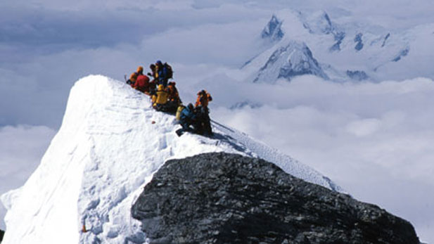 The film team resting on the south summit at 28,750 feet during their descent from the summit in May 2004.