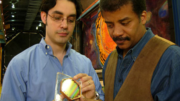 NOVA scienceNOW host Neil deGrasse Tyson (left) and MIT physicist Enectalí Figueroa-Feliciano use a model of a dark matter detector
