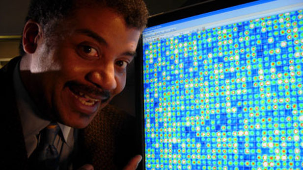 Host Neil deGrasse Tyson confronts his own DNA. The computer monitor displays a microscopic image of a gene chip revealing Tyson's genetic profile.
