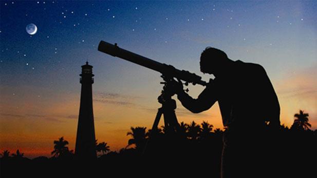 Patrick Ferris peers through telelscope